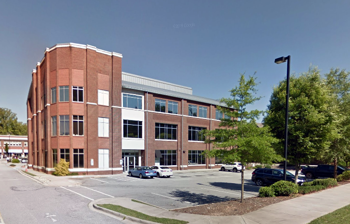 Exterior of a 3 story brick building that houses the DHT offices.