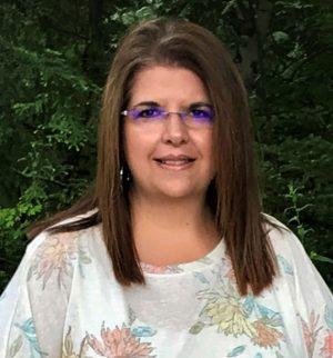 Headshot of Pennie Ewart, Director of Operations
